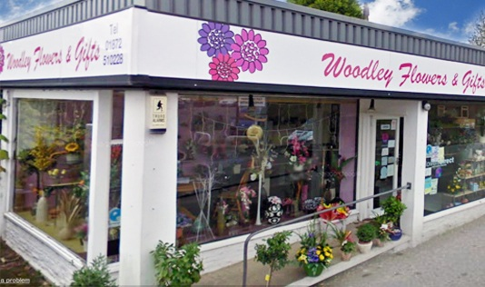 Woodley Flowers logo